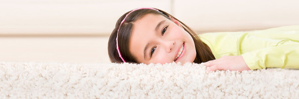 girl laying on carpet